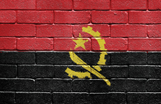 Flag of Angola on brick wall